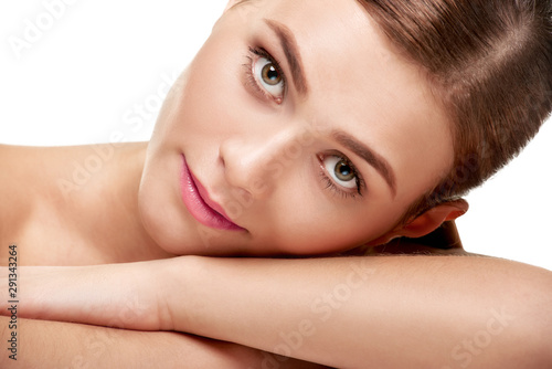 Closeup beauty portrait of pretty young woman with clean facial skin Canvas Print
