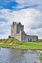 View Of Dunguaire Castle In Ireland At Low Tide.