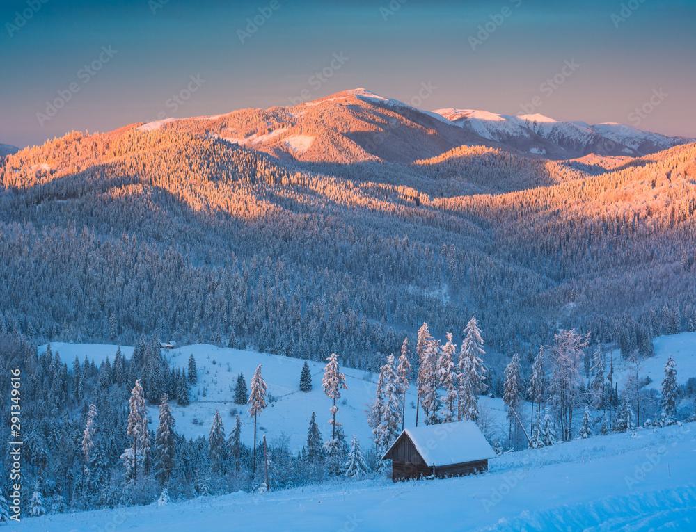 Fototapeta Mountain valley in a light of rising sun