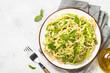canvas print picture Pasta spaghetti with zucchini top view.