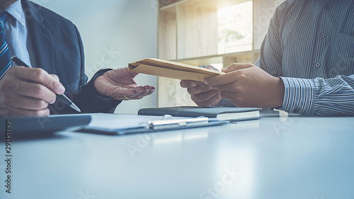 Businessman giving money while making deal to agreement a real estate contract and financial corporate Tableau sur Toile
