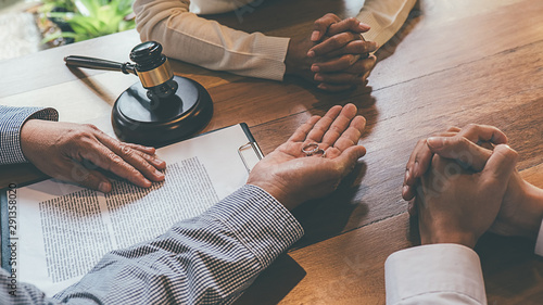 Judge gavel with Justice lawyers deciding, consultation on marriage divorce between married couple and signing divorce documents on table Wallpaper Mural