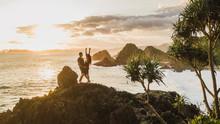 Couple Enjoying Sunset With Am...