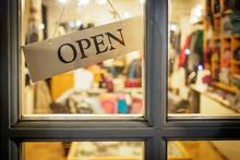 Open Signboard On Shop Door. Landscape Format.