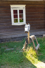 Authentic Wooden Horse, Which Peasants Of Northern Europe, Finland, Karelia Used To Cut Down With An Ax From A Wooden Block And Poles For Their Children. Seurasaari Island In Finland.