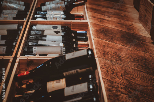 Photo sur Toile Amsterdam Luxury wine stock in private boutique, big selection of red wine are kept in wooden boxes.