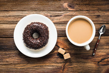 Donut And Coffee With Cream On Wooden Table Background, Top View. Breakfast Food
