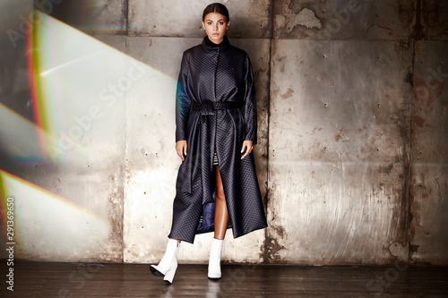 Beautiful young sexy woman lady stylish elegant fashionable dress makeup and hair style for the evening business meeting walk date designer dress with accessories lather black high heels skin tan Fototapeta