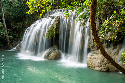 Wall Murals Waterfalls Erawan water fall (Second floor), tropical rainforest at Srinakarin Dam, Kanchanaburi, Thailand.Erawan water fall is beautiful waterfall in Thailand. Unseen Thailand - Image