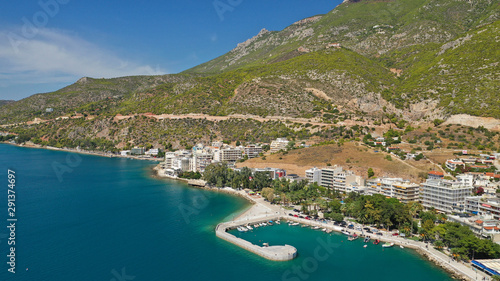 Photo Stands Egypt Aerial drone photo of famous seaside area and main town of Loutraki with sandy organised beach with turquoise clear sea and resorts, Greece