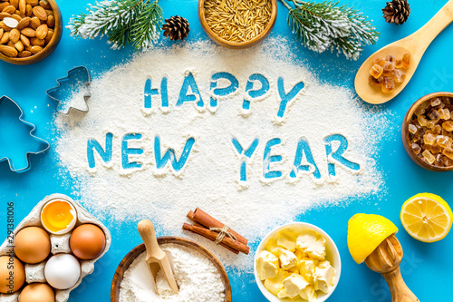 Fototapety, obrazy: Happy New Year written on blue baking background top view