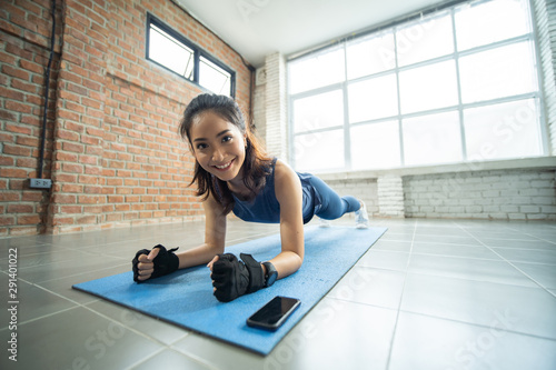 Asian women exercising in the gym, she was pretending to