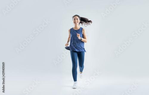 Obraz na plátně  Asian woman run marathon studio white background.