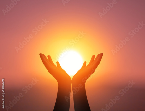 World Mental Health Day concept: Silhouette prayer hands in the sunset sky backg Fototapet