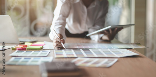 Fototapeta Young professional UI graphic designer choosing colours for their smartphones templates obraz na płótnie