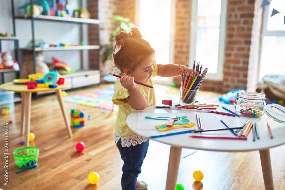 Fototapety, obrazy: Beautiful toddler standing holding colored pencils at kindergarten