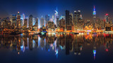Fototapeta Nowy Jork - Panoramic view on Manhattan at night, New York, USA