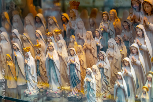 statues or figurines in a shop, the commercial side of Lourdes. Wallpaper Mural