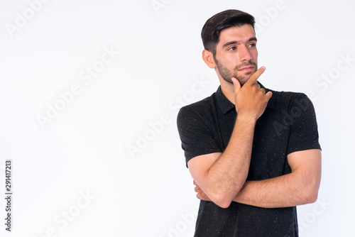 Portrait of young bearded Persian man thinking and looking up Poster Mural XXL