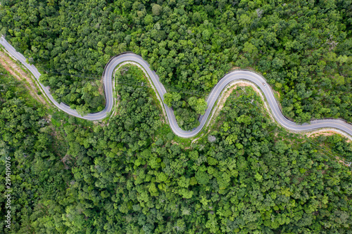 Obraz Drone view of curvng road . - fototapety do salonu