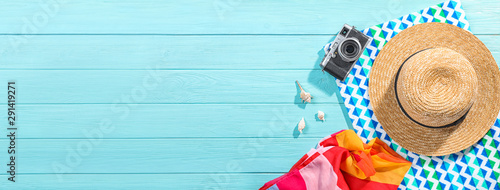 Obraz Flat lay composition with beach accessories on wooden background. Space for text - fototapety do salonu
