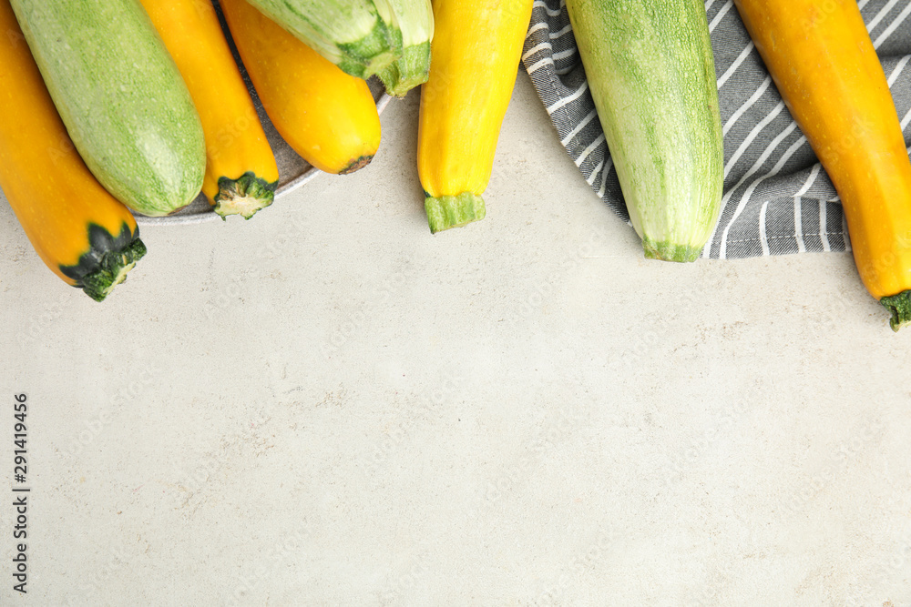 Fototapety, obrazy: Flat lay composition with fresh ripe zucchinis on light table, space for text