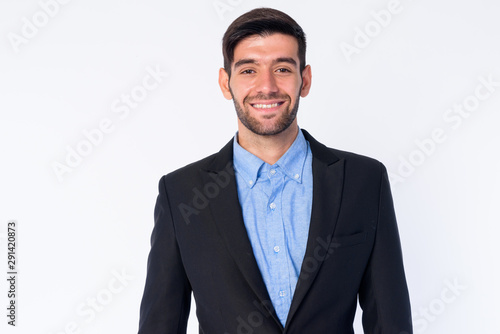 Obraz na plátně  Portrait of happy young bearded Persian businessman in suit smiling