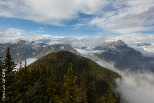 Mountains with Fog and Rainbow