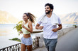 canvas print picture Happy people jogging outdoor. Running, sport, exercising and healthy lifestyle concept