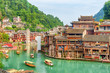 Leinwanddruck Bild - Gorgeous view of wooden tourist boats on the Tuojiang River
