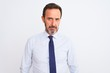 Middle age businessman wearing elegant tie standing over isolated white background skeptic and nervous, frowning upset because of problem. Negative person.