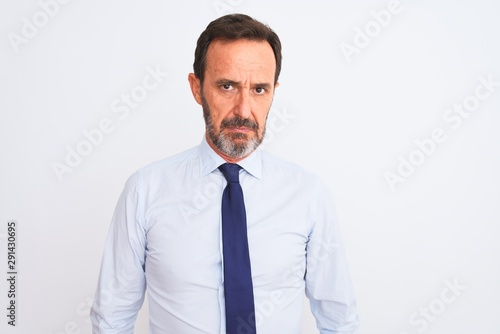 Fototapety, obrazy: Middle age businessman wearing elegant tie standing over isolated white background skeptic and nervous, frowning upset because of problem. Negative person.