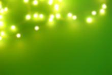 Blurred Christmas Lights On Color Background