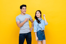 Asian Handsome Man Pointing Finger At Smiling Woman