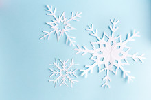 Blue Background With Paper Snowflake, Top View