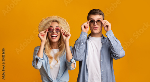 Fototapeta Young couple trying on trendy sunglasses, getting ready for vacation obraz
