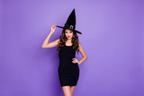 Trick-or-treat. Portrait of charming woman witch gothic creepy fantasy creature of darkness want spell magic scary people feel coquette wear mini dress isolated over violet color background