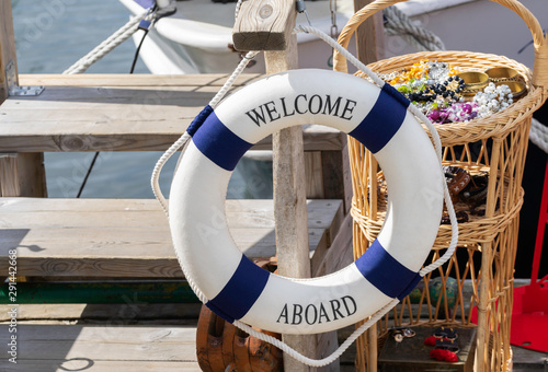 Lifebuoy decoration on a wooden aboard, welcome aboard. Wallpaper Mural