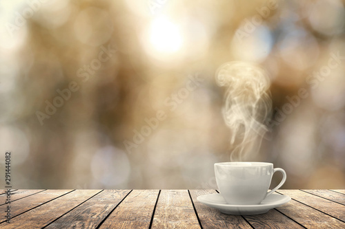 Obraz hot coffee on the table on a winter background - fototapety do salonu