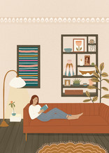 Woman On A Sofa Reading A Book