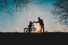 Silhouette Of Happy Father And...