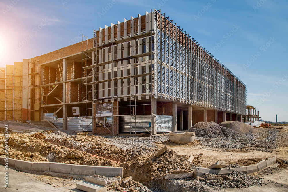Fototapety, obrazy: Construction site background. Hoisting cranes and new multi-storey buildings. I.ndustrial background.Building construction site work against blue sky