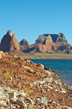 The Lone Shore Of The Wide Red Rock Lake Powell Landscape In Summer.