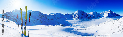 Fotografía Ski in winter season, mountains and ski touring backcountry equipments on the top of snowy mountains in sunny day