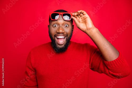 Fotografija  Portrait of impressed guy with eyewear eyeglasses screaming wow omg hear wonder