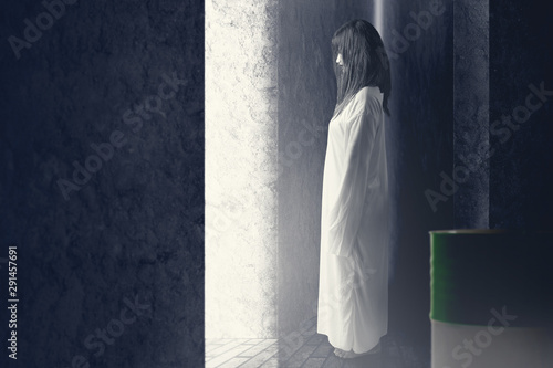 Scary ghost woman with blood and angry face haunted the abandoned building Canvas Print