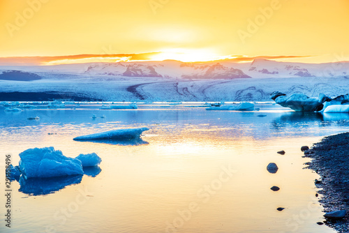 Foto auf AluDibond Melone Magical landscape with ice depths in the famous Jokulsarlon glacial lagoon in Iceland at sunset. Exotic countries. Amazing places. Popular tourist atraction. (global warming – concept)