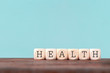 canvas print picture Health word written in wooden cube on wooden table , Healthcare and medical Insurance concept