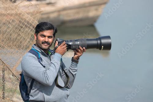 Wildlife photographer with camera, Bhigwan, Pune, Maharashtra, India Wallpaper Mural
