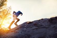 Man Runs Uphill On Big Rock At...